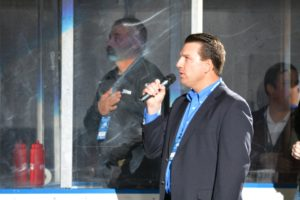 Dr. E. J. Brophy sings the national anthem prior to Friday's game. Photo credit: Jazzmine Jordan