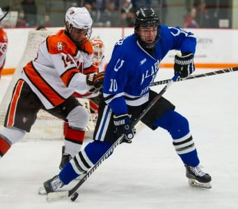 Brent Fletcher has the puck while pursued by BG's Mark Friedman. (Photo by Todd Pavlack, BGSUHockey.com)