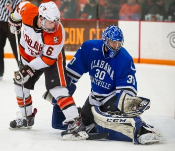 Matt Larose, who came into the game in relief, makes a stop on Bowling Green's Mitchell McLain. (Photo by Todd Pavlack/BGSUHockey.com)