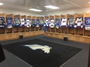 The UAH locker room at the Von Braun Center, displaying the five sweaters the Chargers will wear this season.