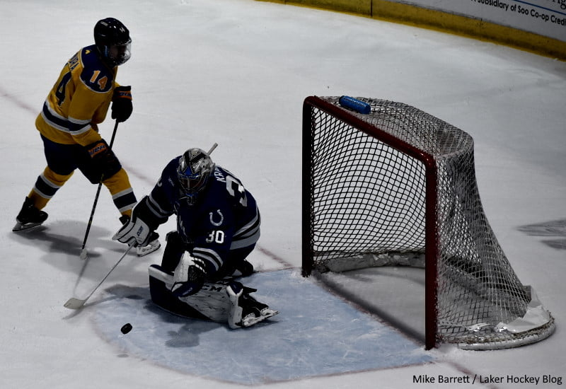 UAH goaltender Derek Krall makes the save on the penalty shot by Lake Superior State forward Yuki Miura. Photo by Mike Barrett/Laker Hockey Blog